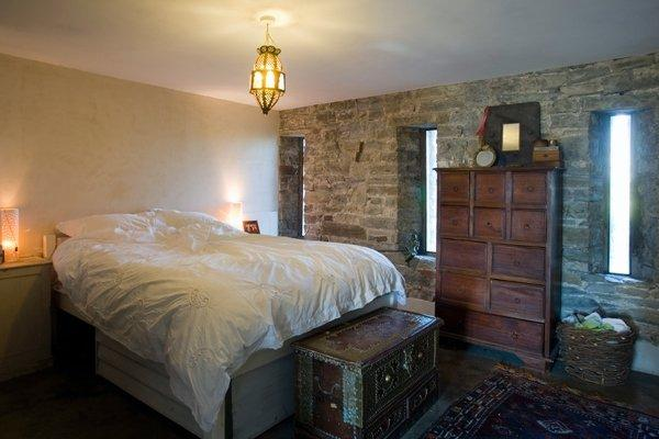 the bedroom with stone wall