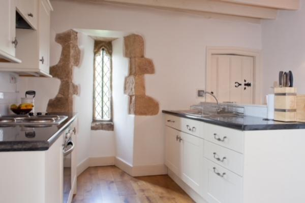 Kitchen with stone feature window