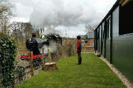 steam train passing the carriage
