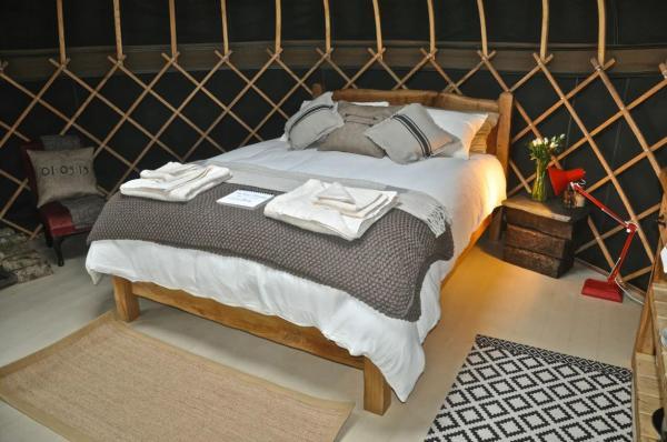 double bed in cosy yurt