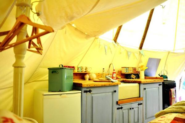 fully equipped kitchen in the tipi