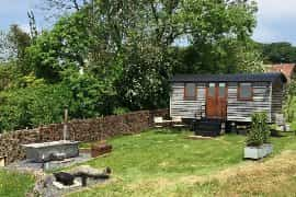 the shepherds hut and hot tub