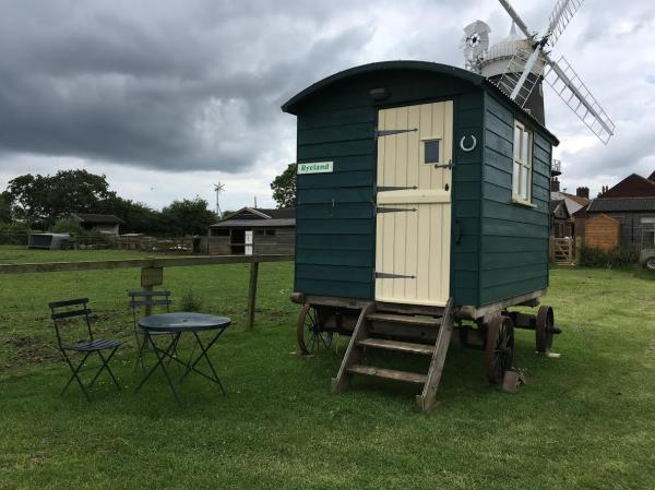 hut with windmill behind