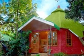 the unusual cottages are set in a lovely garden