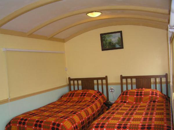 twin bedroom inside the carriage