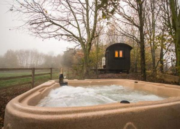 the private hot tub a short distance away