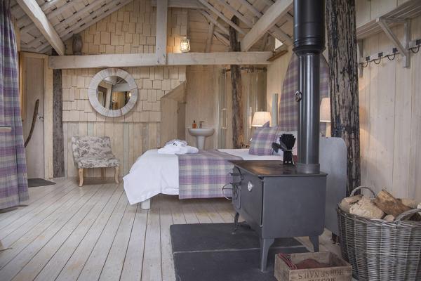 woodburner in cosy bedroom