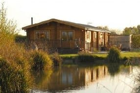 Luxury lodges at the edge of a lake