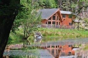 Penvale Lake Lodges at the edge of a lake