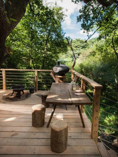 outdoor terrace with pizza oven for treehouse