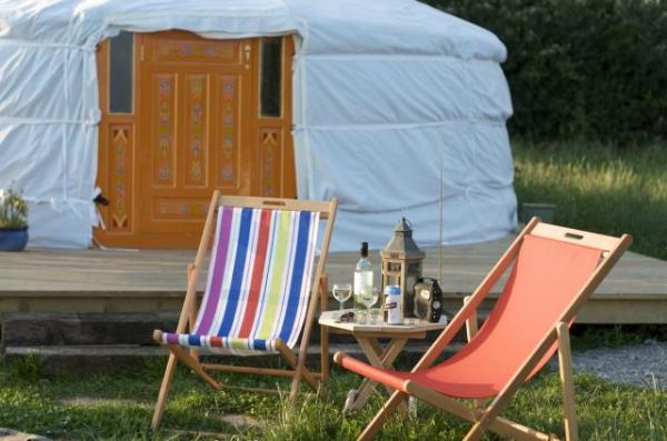 deskchairs outside a yurt