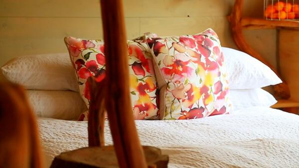 double bed inside treehouse