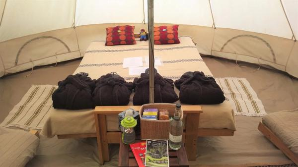 Bell tent interior with gowns