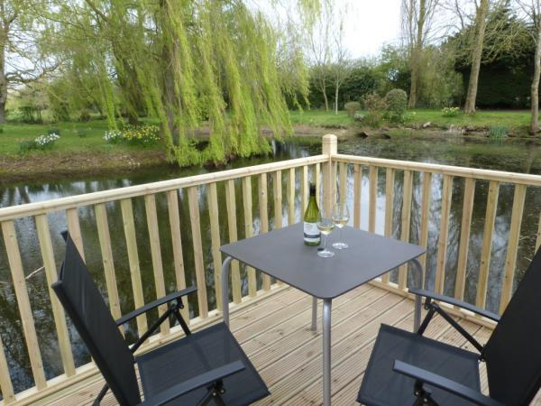 picturesque outdoor seating by pond