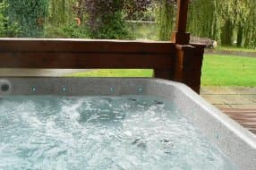 hot tub with lake outlook