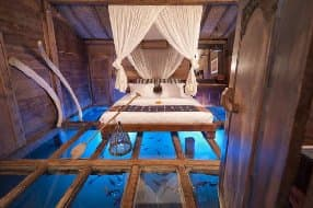 room with glass floor over pond