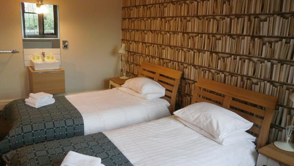 twin bedroom with book wallpaper