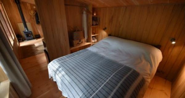 Double bedroom in treetop cabin