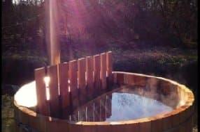 Wood burning hot tub outside yurt