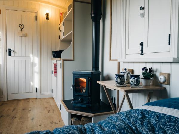 Bed with woodburner