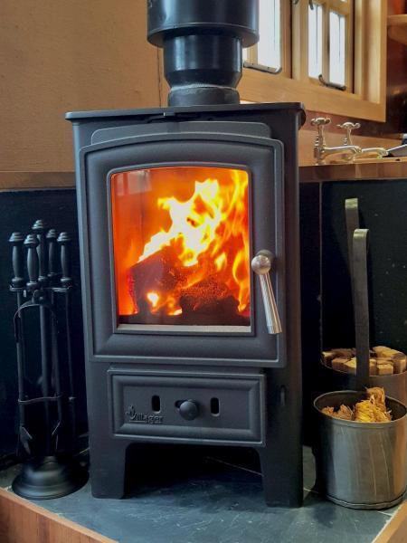 Cozy Log burner in the Ashwood Hut