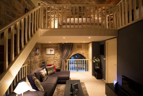 Open plan lounge with mezzanine level bedroom
