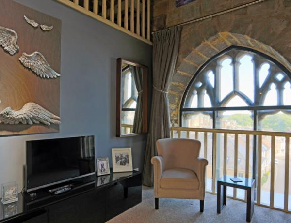 Large original tower windows and seating area