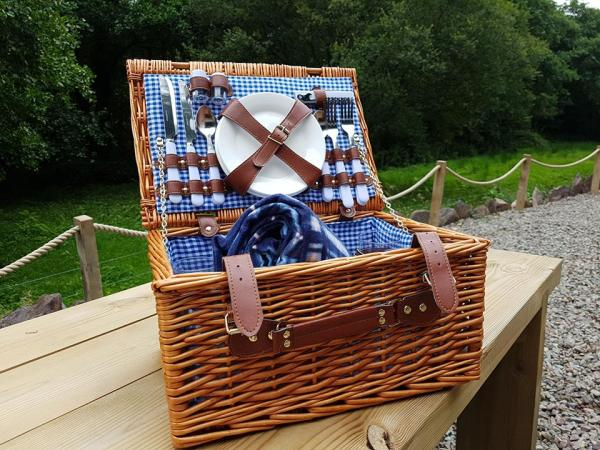 Pack a picnic and go for a stroll in the woods