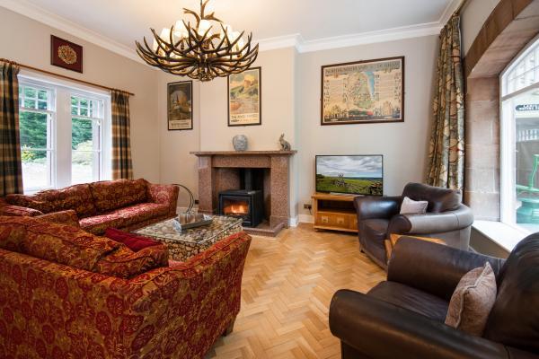 Spacious lounge with wood burner