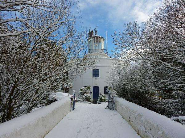 the lighthouse in snow