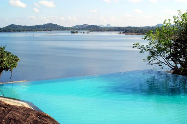 infinity pool looks over lake