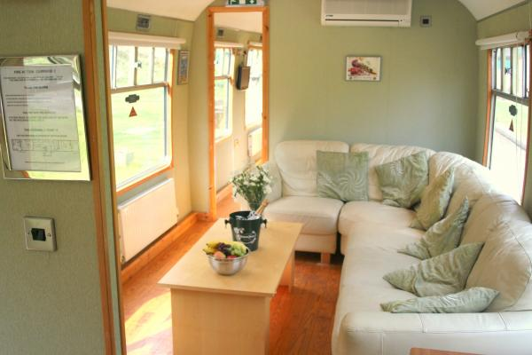 Carriage 2, Lounge leading to en-suite bedroom