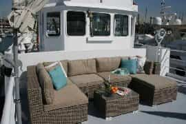 Lounge area on front deck, with lovely views over marina and to sea!