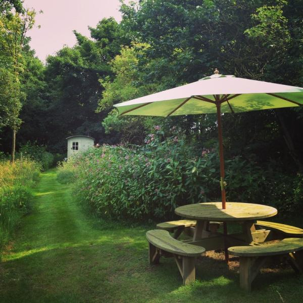 outdoor seating and path to hut