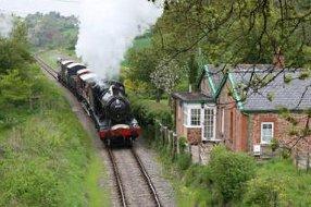 Railway Cottage next to a steam train line