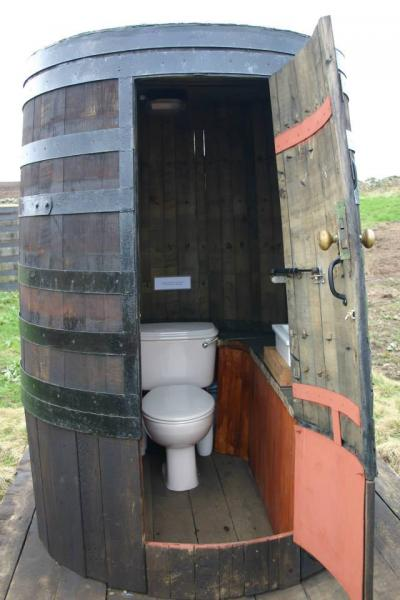 a unique whisky barrel loo