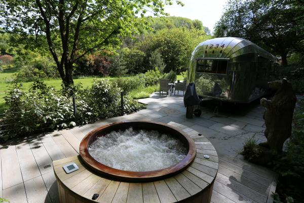 view to airstream from the hot tub