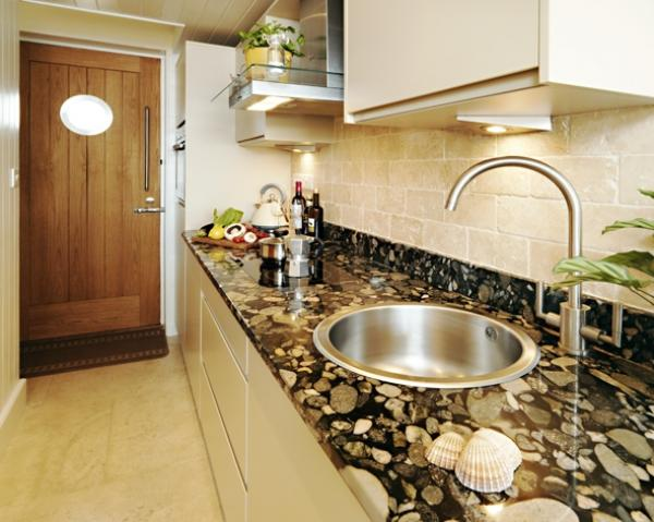the kitchen area in the stylish hut