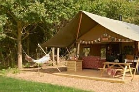 A wildlife conservation charity offers exciting gl&ing options near Woodbridge with a hot tub. Closed in winter. & glamping with hot tub