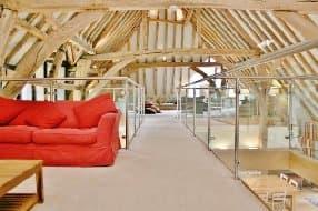 Great Higham Barn top floor beams and seating